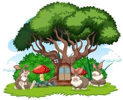 casa sull'albero con tre conigli