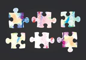 Pezzi di puzzle acquerello vettoriale