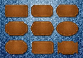 Vettore di jeans di distintivi in pelle gratis