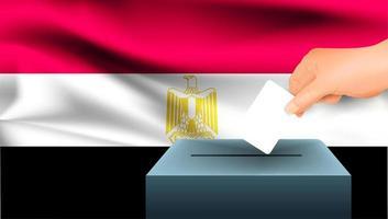 mano che mette scheda elettorale nella casella con la bandiera egiziana vettore