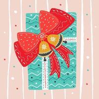 regalo di Natale disegnato a mano con nastro, campane e fiocco