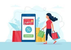donna con borse della spesa, smartphone con carta di credito