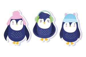 pinguini con cappelli invernali e paraorecchie antartici vettore