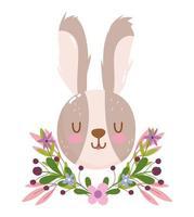 simpatica testa di coniglio con decorazioni di fiori e fogliame vettore