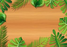 fondo in legno con fogliame tropicale