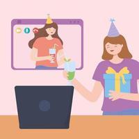 festa in linea. giovani donne che celebrano il compleanno con il computer portatile