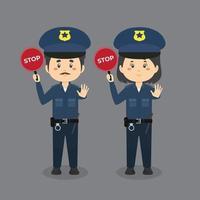 polizia che tiene il segnale di stop