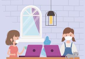 giovani donne sul portatile al chiuso