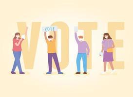 persone mascherate che fanno campagna davanti a un grande testo di voto