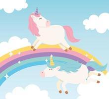 personaggi dei cartoni animati di unicorni magici con arcobaleno vettore
