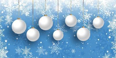 banner di Natale con palline appese sul disegno del fiocco di neve vettore