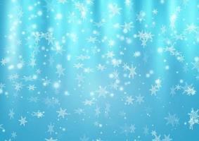 sfondo blu di Natale con fiocchi di neve che cadono vettore