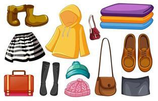 set di abiti di moda e accessori su sfondo bianco
