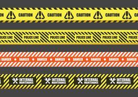 Segni di nastro adesivo di pericolo vettore
