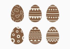Collezione di uova di Pasqua al cioccolato fondente vettore