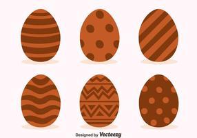 Vettori deliziosi di uova di Pasqua al cioccolato