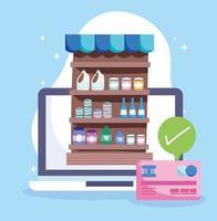 mercato online tramite computer con carta di credito vettore