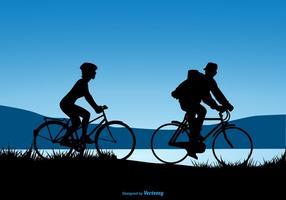 Disegno della siluetta di una coppia che guida le biciclette vettore