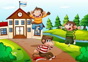 tre scimmie che giocano nella scena della scuola