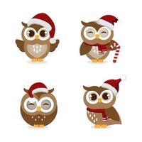 set di gufi che indossano il cappello di Babbo Natale per Natale vettore