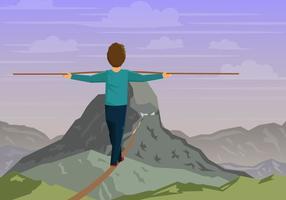 Uomo che fa il funambolo nella montagna