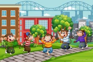 cinque scimmiette che saltano nella scena della città