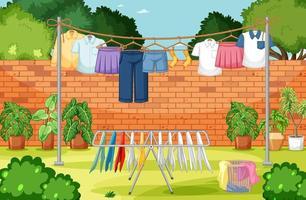 vestiti stesi in linea nel cortile vettore