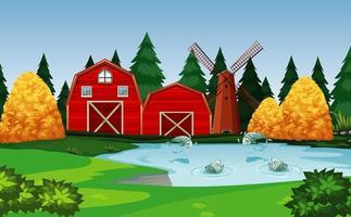 fattoria con fienile rosso e scena di mulino a vento