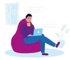 uomo che utilizza il laptop a casa