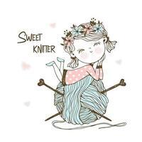 piccola magliaia carina con un'enorme matassa di filo.
