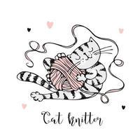 gattino carino che gioca con un gomitolo di lana.