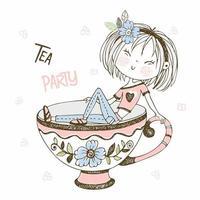 ragazza carina che beve il tè. tea party.