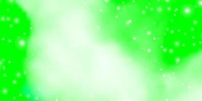 sfondo verde chiaro con piccole e grandi stelle.