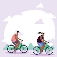 persone con maschere facciali andare in bicicletta all'aperto