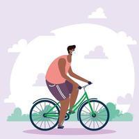 uomo con maschera facciale in sella a una bicicletta all'aperto