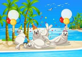 gruppo di foche nel personaggio dei cartoni animati a tema di festa su sfondo spiaggia