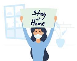 donna che tiene un segno di soggiorno a casa