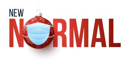 nuovo normale banner natalizio con ornamento palla mascherata