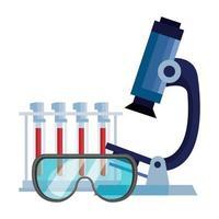 microscopio con provette e occhiali di protezione