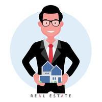 mediatore o agente immobiliare che offre una casa stando in piedi mentre si tiene in mano un modello di proprietà vettore