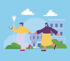 ragazze con smartphone che camminano nella strada della città vettore
