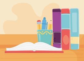 formazione in linea, libri aperti e forniture di cancelleria per libri in piedi