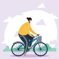giovane africano che indossa la mascherina medica nel carattere della bicicletta