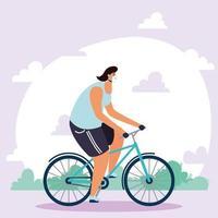 giovane uomo che indossa la mascherina medica in bicicletta