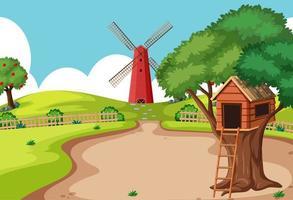 casa sull'albero nella scena della fattoria con mulino a vento vettore