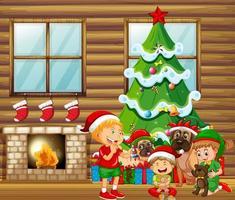 scena natalizia al coperto con molti bambini e simpatici cani vettore