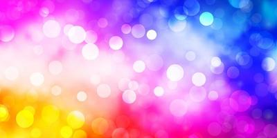 sfondo vettoriale rosa chiaro, blu con cerchi.