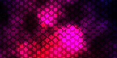 sfondo vettoriale viola scuro in stile poligonale.