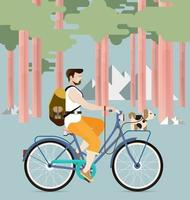 uomo in sella a una bicicletta con il vettore del cane