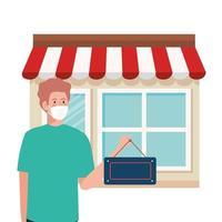 riaperto dopo quarantena, uomo con etichetta di riapertura negozio, siamo di nuovo aperti, facciata negozio negozio